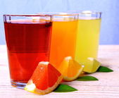 Grapefruit, oranges, lime - Citrus juices in glass — Stockfoto