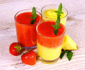 Strawberry and pineapple smoothie in glass mixed — Stock Photo