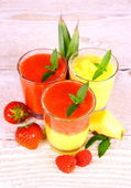 Raspberry, strawberry and pineapple smoothie mixed, deco — Stock Photo