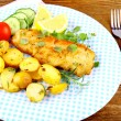 Stock Photo: Fried fish fillet with vegetables and rosemary potatoes