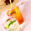 Mojito, orange cocktails with straw and holiday background — Stock Photo