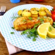 Stock Photo: Fried fish fillet with rosemary potatoes, vegetables
