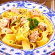 Salmon fish with taglatelle and fork — Stockfoto #31148739