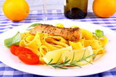 Grilled salmon fillet, taglateli, lemon and herbs — Stock Photo