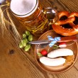 Oktoberfest menu with beer, white sausage, pretzel and radish — Stock Photo