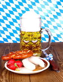 Beer, white sausage, pretzel and radish - Oktoberfest menu — Stock Photo