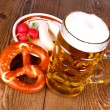 Beer with pretzel, white sausage and radish — Stock Photo #31228007
