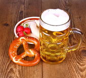 Beer and pretzel, radish and white sausage — Stock Photo