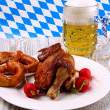 Oktoberfest chicken with radish, pretzel and beer — Stock Photo