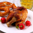 Chicken for Oktoberfest with radish, pretzel and beer — Stock Photo