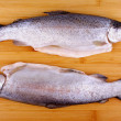 Two fresh whole trout on bamboo board — Stock Photo