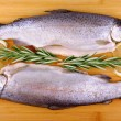 Two fresh whole trout, lemon and rosemary — Stock Photo