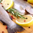 Two fresh rainbow trout with spices, red pepper and lemon — Stock Photo