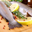 Two whole rainbow trout with spices, red pepper and lemon — Stock Photo