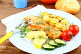 Fried fish fillet with rosemary potatoes and vegetables — Stock Photo