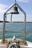 Ship at sea with view of lighthouse deck and bell — Stock Photo