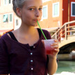 Stock Photo: Cute girl with red slush drink