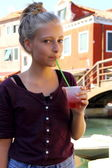 Cute girl with red slush drink — Stock Photo
