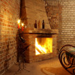 Vintage interior with rocking chair by fireplace and candles — Stock Photo