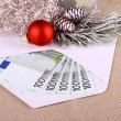 500 euro money in envelope with Christmas deco — Stock Photo