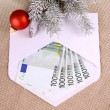 Christmas bonus - five hundred euro in envelope and decor — Stock Photo