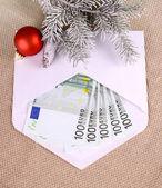 Christmas bonus - five hundred euro in envelope and decor — Stock Photo