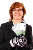 Redhead business woman holding money in Christmas winter gloves — Stock Photo
