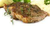 Grilled pork steak with potato salad and herbs — Zdjęcie stockowe