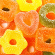 Colorful jelly candies in heart shape and gear as background — ストック写真
