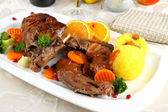 Braised rabbit meat with vegetables and potato dumplings — Stock Photo
