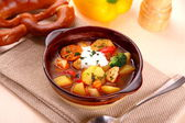 Vegetable stew with chicken and potato, pretzel — Stock Photo