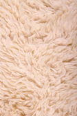 White lambskin as background, vertical — 图库照片