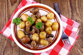 Brown mushrooms fried with round potato — Stock Photo