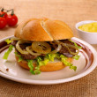 Stock Photo: Ochsensemmel, grilled beef with onion rings in bread rolls