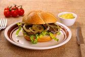 Ochsensemmel, grilled beef with onion rings in bread rolls — Stock Photo