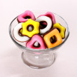 Colored candy with pink heart in glass bowl — Stock Photo #38313433