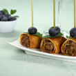 Pancake roll stuffed with minced meat as snack — Stock Photo