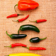 Hot pepper collection on jute background — Stock Photo #38529371