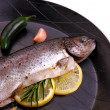 Marinated rainbow trout with lemon, carrot on frying pan — Stock Photo #38569611