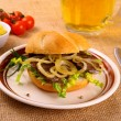 Ochsen Semmel - Grilled beef with onion rings in bun — Stock Photo