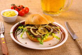 Ochsen Semmel - Grilled beef with onion rings in bun — Stok fotoğraf