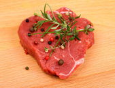 Juicy beef steak with spices and herbs — Stock Photo