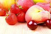Strawberries, platt peach, cherries, lemon and mango — Stock Photo
