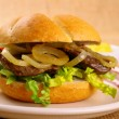 Ochsen Semmel - Grilled beef with onion rings in bun — Stock Photo #39496963