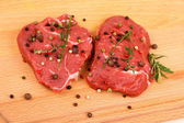 Two juicy beef steak with spices and herbs — Stock Photo