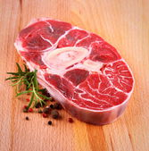Fresh veal shank meat with herb on wood background — Stock Photo