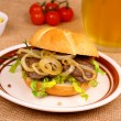 Grilled beef with onion rings in bun, mustard, beer — Stock Photo #40007275