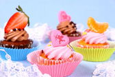 Appetizing cupcakes with angel, heart, tangerine, strawberry — Stock Photo
