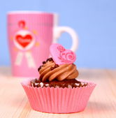 Chocolate cupcakes with Heart and coffee cup — Stock Photo