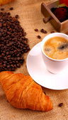 Coffee in white cup and croissant — Stock Photo